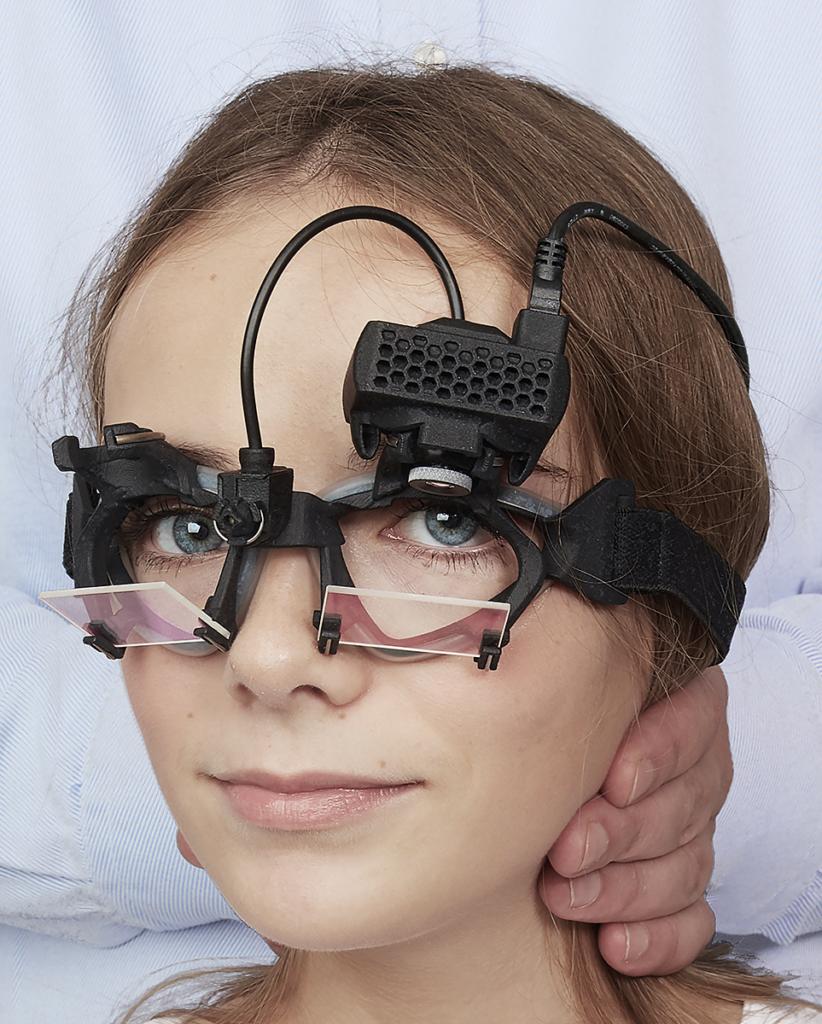 patient wearing eye tracking equipment